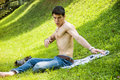Attractive young man on grass scared by insects Royalty Free Stock Photo