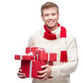 Attractive young man holding red gift casual isolated on white Stock Image