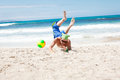 Attractive young man playing volleyball on the beach summertime Stock Photo