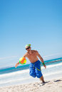 Attractive young man playing volleyball on the beach summertime Royalty Free Stock Images