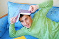 Attractive young man reading a book. Royalty Free Stock Photos
