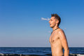 Attractive young man in the sea getting out of water with wet ha hair Stock Image