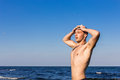 Attractive young man in the sea getting out of water with wet ha hair Royalty Free Stock Photo