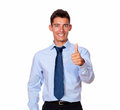 Attractive young man standing with ok sign a portrait of an on blue shirt while smiling at you on isolated studio Royalty Free Stock Photo