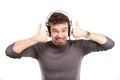 Attractive young man wearing headphones white background Stock Photo