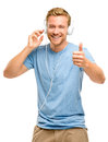 Attractive young man wearing headphones on white background Royalty Free Stock Photo