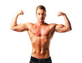 Attractive young muscular man naked posing double biceps pose standing isolated Royalty Free Stock Image