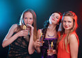 Attractive young people dancing at disco and having fun Royalty Free Stock Photography