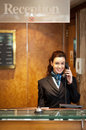 Attractive young receptionist receiving calls Stock Images