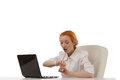 Attractive young redhead female office worker businesswoman looking her watch surprise time sits her desk working laptop Stock Image
