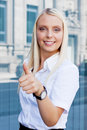 Attractive young successful smiling business woman standing outdoor in summer Stock Images