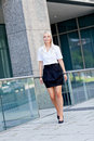 Attractive young successful smiling business woman standing outdoor in summer Stock Photography