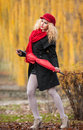 Attractive young woman in a autumn fashion shoot beautiful fashionable young girl with red accessories outdoor umbrella cap and Royalty Free Stock Images