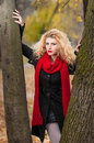 Attractive young woman in a autumn fashion shoot beautiful fashionable young girl with red scarf in the park blonde women Stock Photo