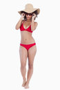 Attractive young woman in beachwear standing upright Royalty Free Stock Photos