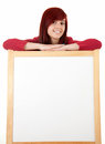 Attractive young woman with blank poster Stock Photos