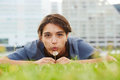 Attractive young woman blowing dandelion on green field Royalty Free Stock Photo
