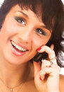 Attractive young woman calling by cellular phone. Royalty Free Stock Photo