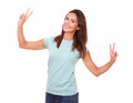 Attractive young woman celebrating her victory portrait of on blue t shirt while standing and smiling at you with funny face on Stock Photos