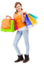 Attractive young woman with colorful shopping bags isolated Stock Image