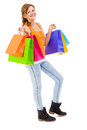 Attractive young woman with colorful shopping bags isolated Royalty Free Stock Image