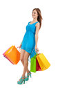 Attractive young woman with colorful shopping bags isolated on white background Royalty Free Stock Photography