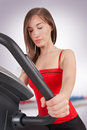 Attractive young woman doing cardio workout Stock Images