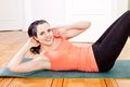 Attractive young woman doing sit ups at home sport workout Royalty Free Stock Photos