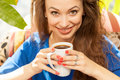 Attractive young woman drinking coffe in a coffee shop Royalty Free Stock Photo