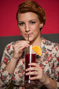 Attractive young woman drinks icetea in a bar Royalty Free Stock Photos