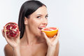 Attractive young woman is eating exotic fruit Royalty Free Stock Photo