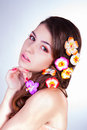 Attractive young woman with flowers in hair fairy looking straight touching her chin by hand Royalty Free Stock Photo