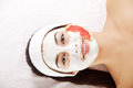 Attractive young woman with fruit mask on a face at spa saloon Royalty Free Stock Photography