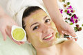 Attractive young woman getting a facial mask in the beauty spa Royalty Free Stock Image