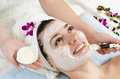 Attractive young woman getting a facial mask in the beauty spa Stock Photography