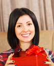 Attractive young woman with gift box casual holding a a huge smile on her face Stock Image