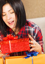 Attractive young woman with gift box casual holding a a huge smile on her face Stock Photos