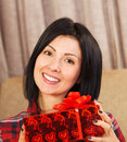 Attractive young woman with gift box casual holding a a huge smile on her face Stock Images