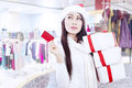 Attractive young woman with gift card at mall Royalty Free Stock Images
