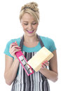 Attractive young woman grating cheese happy Stock Photo