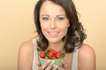Attractive Young Woman Holding a Bowl of Fresh Ripe Strawberries Royalty Free Stock Photo