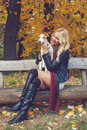 Attractive young woman holding a dog in her arms Royalty Free Stock Image