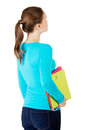 Attractive young woman holding files looking up. Royalty Free Stock Photo