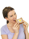 Attractive Young Woman Holding A Slice Of Gala Pie Royalty Free Stock Photo