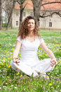Attractive young woman in a lotus position girl pose the park Royalty Free Stock Image