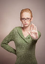 Attractive young woman motioning to stop or halt with hand Royalty Free Stock Image