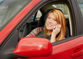 Attractive young woman on phone in car Stock Photo
