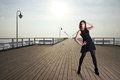 Attractive young woman on the pier full length posing in morning Stock Images
