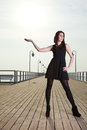 Attractive young woman on the pier full length posing in morning Stock Image