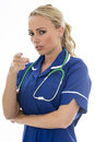 Attractive Young Woman Posing As A Doctor or Nurse Royalty Free Stock Photo